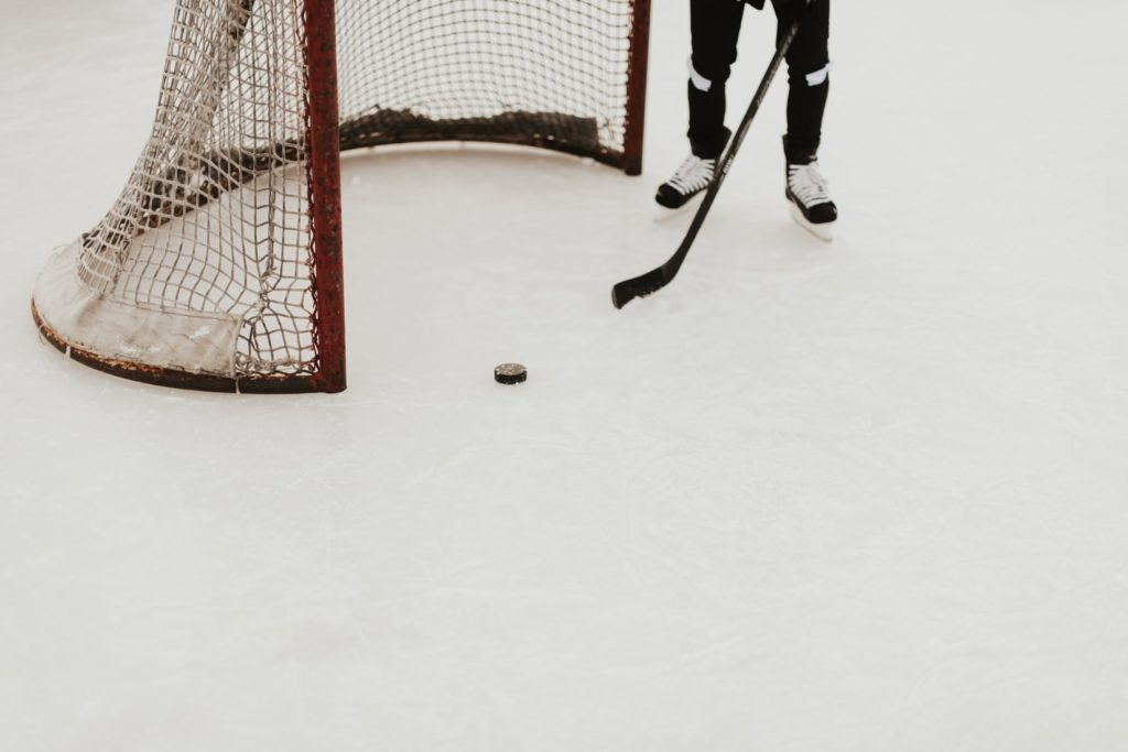 How much does a Hockey Puck weigh